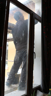 Plastering outside Room 13