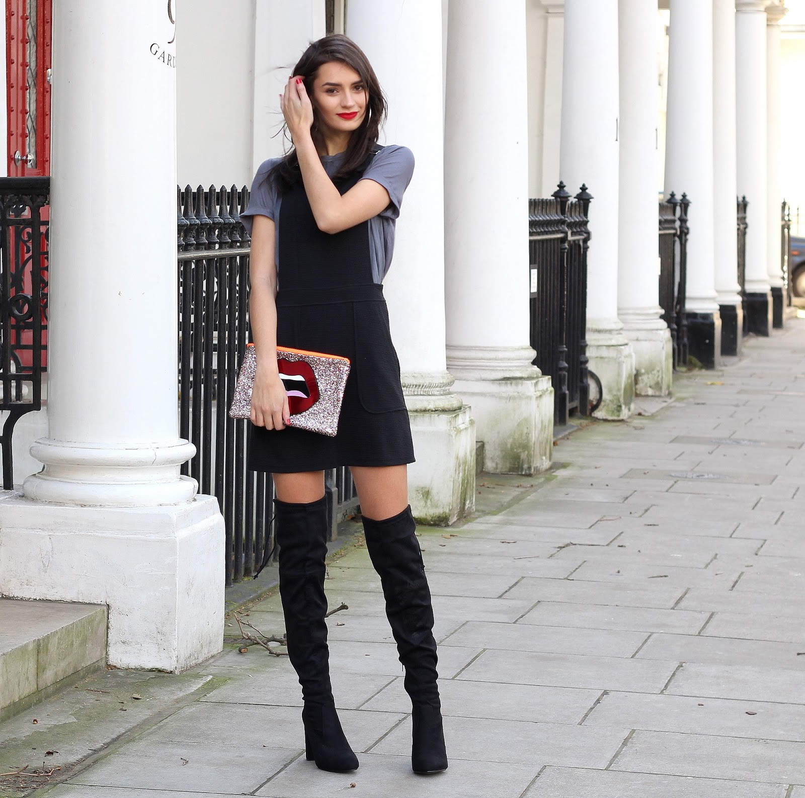 peexo fashion blogger wearing black pinafore dress and knee high boots