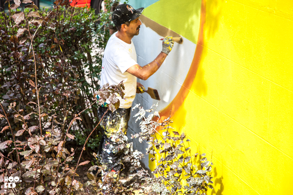Italian Street Artist Giacomo Bufarini at work on his mural with Woodstreet Walls