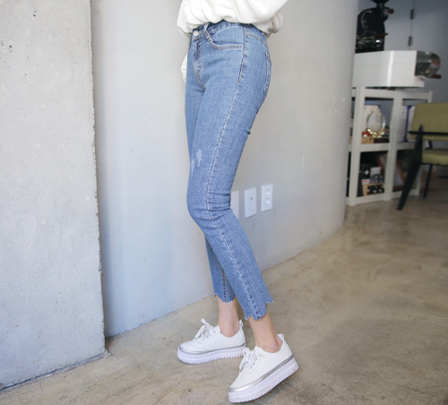 Faded Distressed Blue Jeans