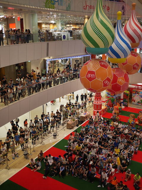 crowd watching soccer match at the apm shopping mall in Hong Kong