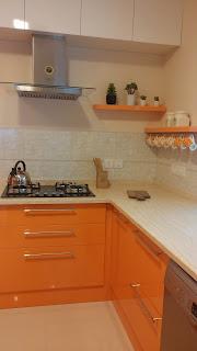 Modular Kitchen Showing Hob Chimney and storage shelves