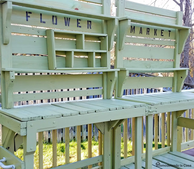 potting benches with flower market sign