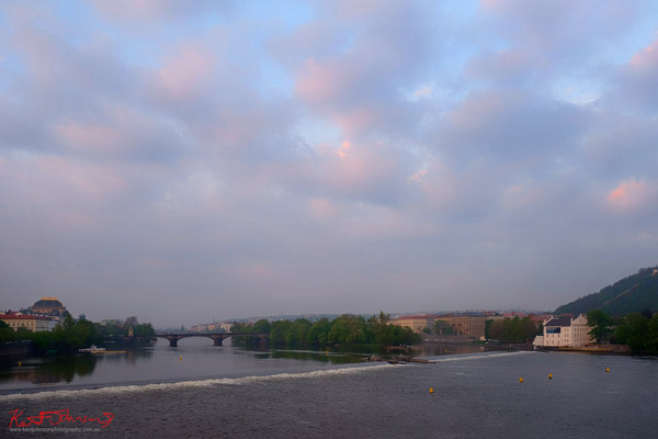 View of the Vlatava river from the Charles Bridge in Spring Prague by Travel and Lifestyle Photographer Kent Johnson.