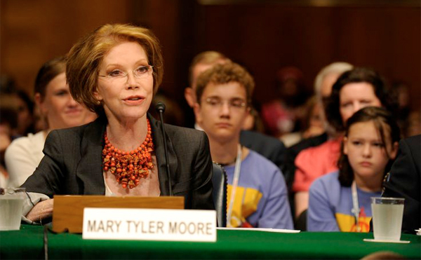 image of Mary Tyler Moore testifying, surrounded by children