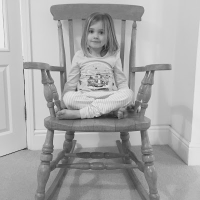 Ellie age 6 sitting in the rocking chair