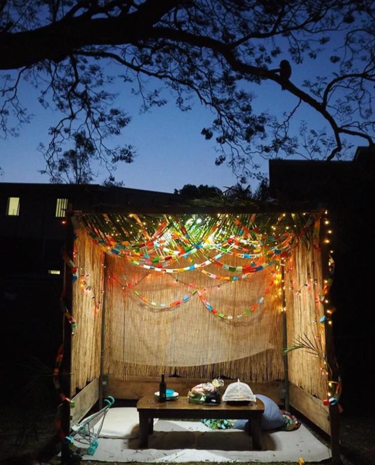 Beautiful sukkah at night | Land of Honey