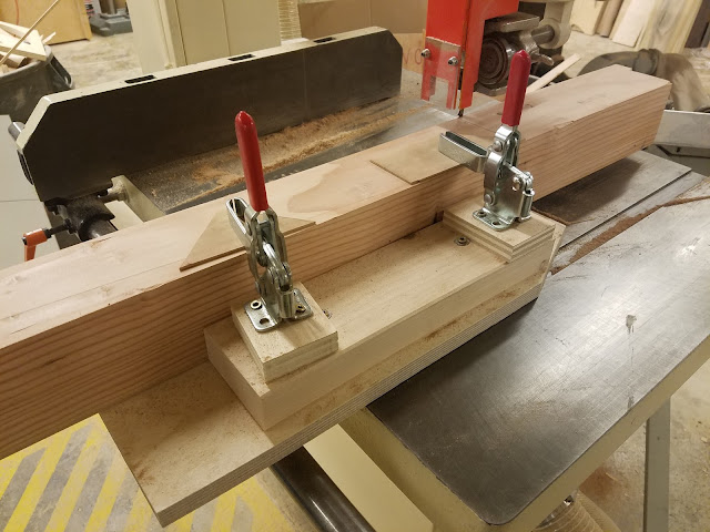 4x4 held at an angle to the bandsaw blade using a plywood jig