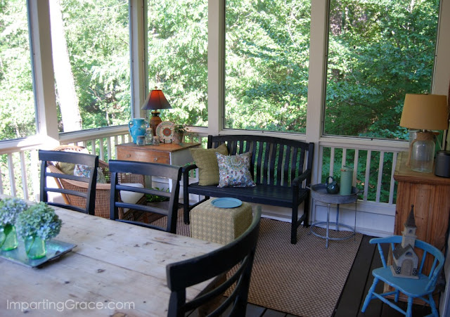 Small sitting area on screened porch is cozy and cool.