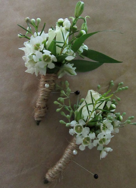 Boutonierres Of White Wax Flower And A Tiny Spray Rose With Seeded Eucalyptus Or Italian Ruscus Bound Pearl Studded Rustic Twine Will Contrast Nicely