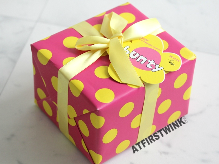 Lush Bunty Pink gift pink yellow polkadot wrapping paper and yellow ribbon with flower shaped ribbon