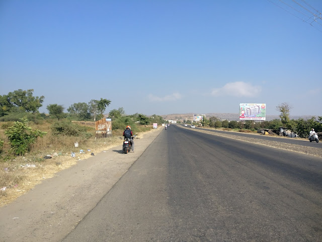 big highway with wide divider amd people riding