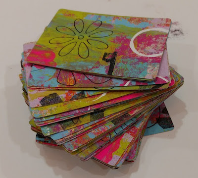 a stack of color artists trading cards