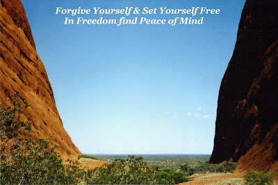 Image of looking between to large rocks out a blue sky, flat horizon with text: Forgive yourself & set yourself free, In freedom find peace of mind