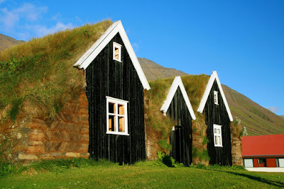 Typical Icelandic mountain huts with grass on the roof