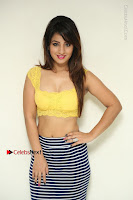 Cute Telugu Actress Shunaya Solanki High Definition Spicy Pos in Yellow Top and Skirt  0004.JPG