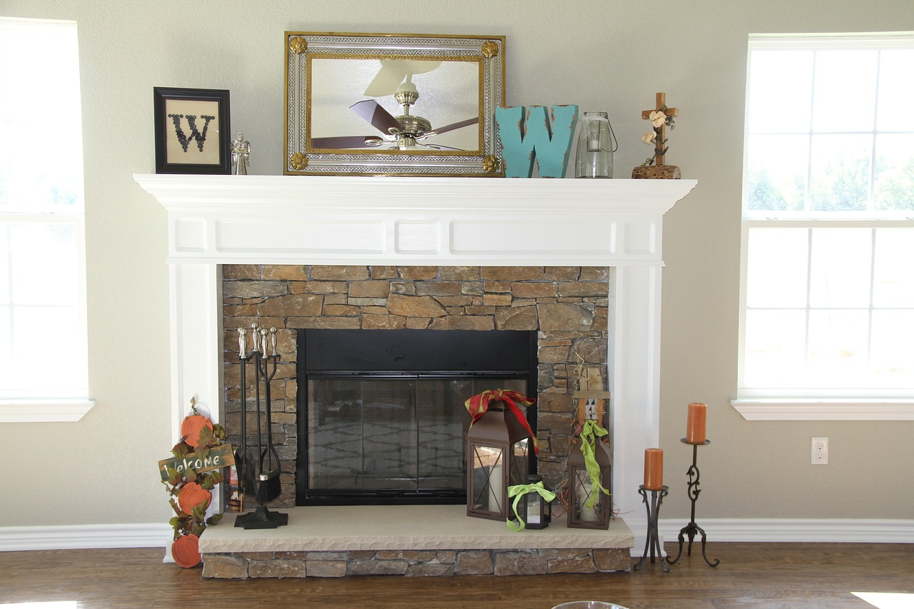 homely looking fireplace with white wooden surround and rustic bricks