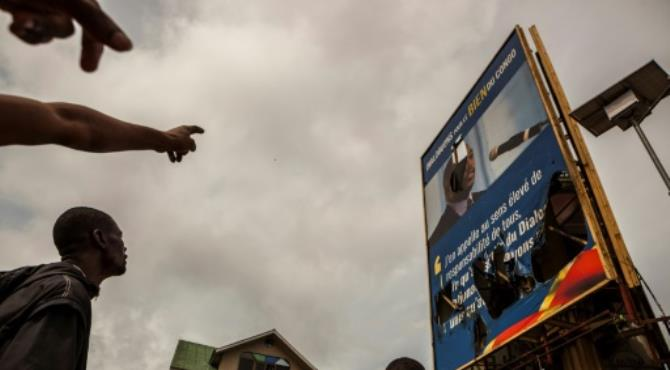 Demonstrators point to a broken billboard showing the face of Congolese President Joseph Kabila during an opposition rally in Kinshasa on September 19, 2016. By Eduardo Soteras (AFP). Kinshasa (AFP) - More than 50 people were killed in clashes between protesters and security forces in the capital of the DR Congo on Monday, opposition groups said in a statement which also called for further demonstrations.  The government had earlier said that at least 17 had died in the violence in Kinshasa, but had warned that the death toll could rise.