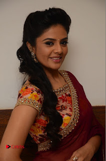 Television Anchor Srimukhi Pictures in Red Saree at Pelli Choopulu Audio Launch  0012.JPG
