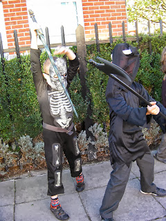 halloween skeleton and axe murderer executioner