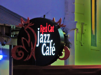 Red Cat Jazz Cafe (2012) Archival pic of neon sign at night