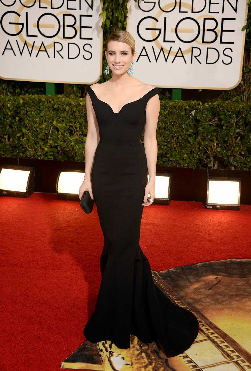 Emma Robert pairs her black Lanvin gown with turquoise chandelier earrings at the 2014 Golden Globes