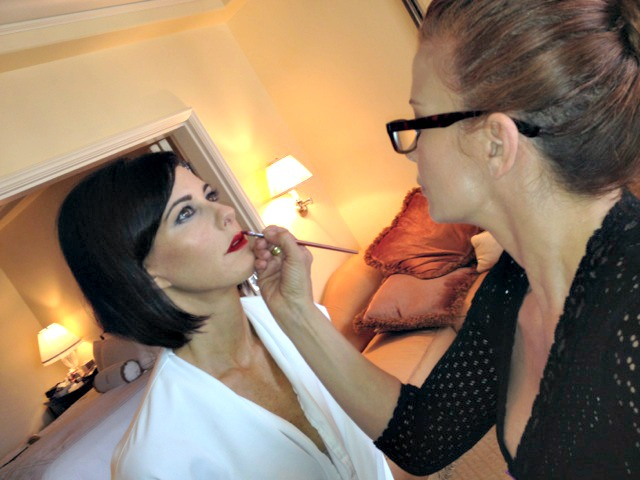 Dyana Aives of Inurface Makeup applying makeup to her client