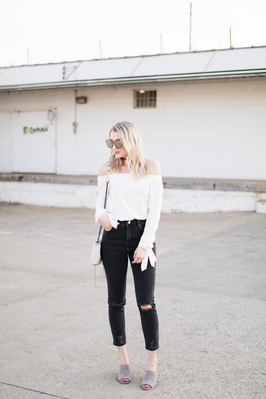 white off-the-shoulder top, black jeans