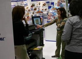 A saleswoman showing how a computer solves a certain problem.