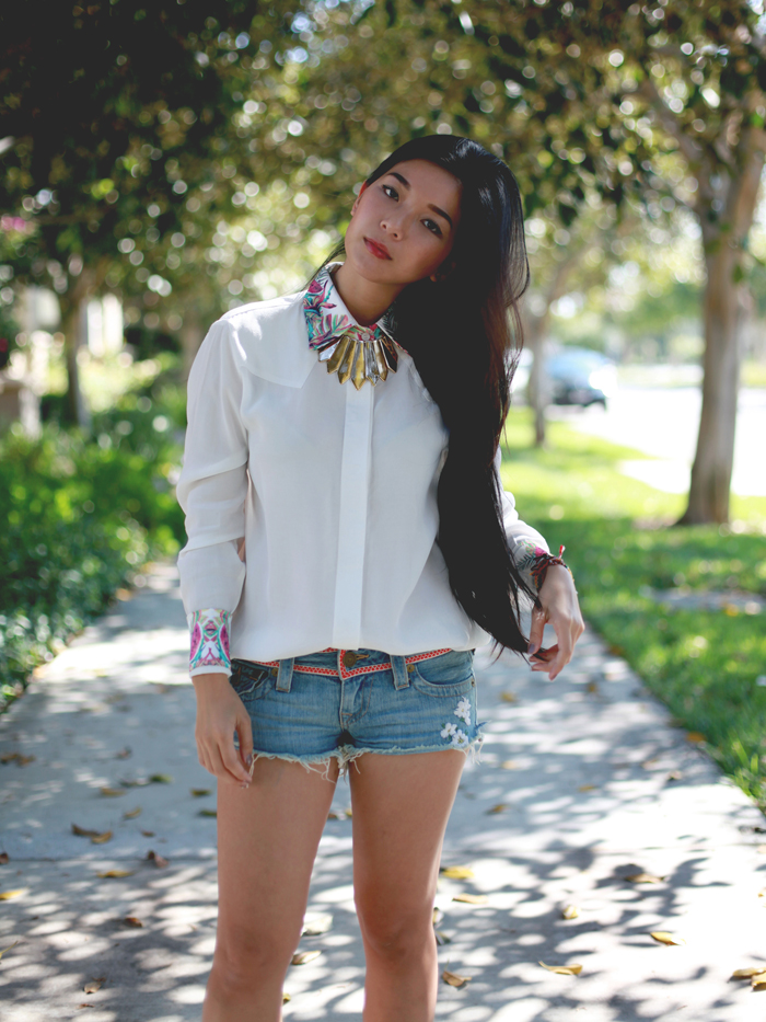 Stephanie Liu of Honey & Silk wearing This is a Love song shirt, True Religion Joey cutoffs, and Matiko sandals