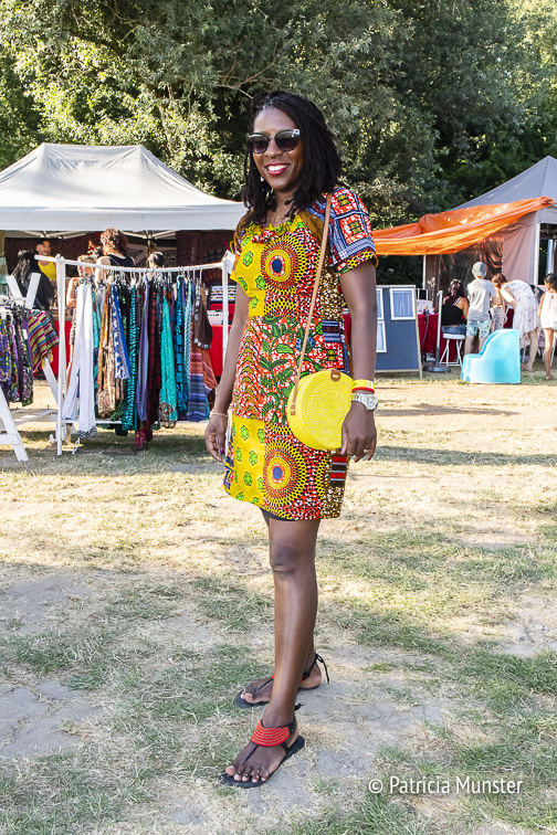 Adeline in a colourful dress with yellow handbag at Rastaplas