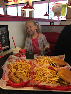 Little Girl with bugers and fries