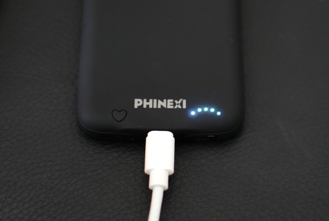 Phinexi-phone-charging-battery-case-review-with-charging-lead-and-lights-on
