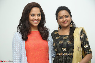 Actress Suma in Black Salwar Suit and Anusuya in orange Dress at winner movie press meet part 1 February 2017 (11).JPG
