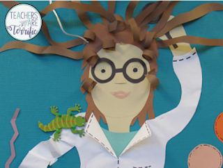 Crazy science lady with wild hair and a lizard on her shoulder! It's part of an old bulletin board that was re-done!