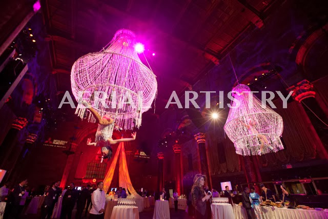 BOOK OR HIRE AN AERIAL BARTENDER OR CHAMPAGNE POURING AERIALIST
