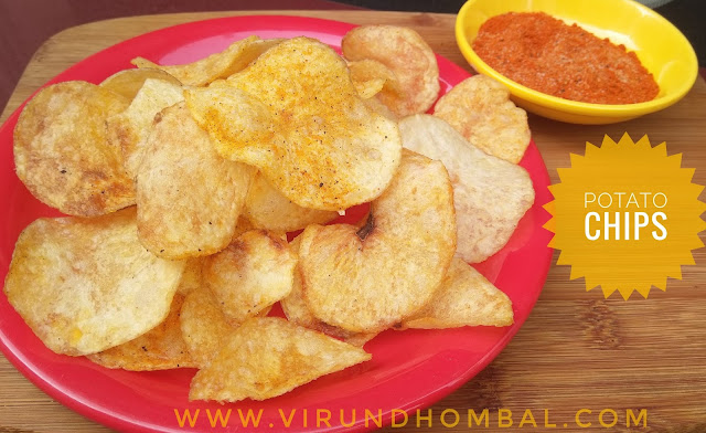 Potato Chips - Potato chips - yummy homemade chips recipe for your kids. Many different kinds of potato chips are available in stores with different flavours and shapes. But homemade products are always safe for us. Do you agree? Tell your kids why homemade snacks are better than store bought snacks. The potato is a commonly used vegetable in our kitchen and you can prepare these chips when you have free time. The potatoes are sliced thinly and then soaked in the water for 20 to 30 minutes to remove the starch in it. After 20 minutes, the slices are dried in a white cloth for 2 hours without any moisture. This method helps to get a  crispy chips. Soaking and drying the slices are the important steps that you must follow for this potato chips. Once the slices are dried without any moisture, then they are deep fried on low heat. For deep frying little patience is very important to get perfect results. Don't be hurry to finish the frying process, because the chips will turn soggy or you will get a brown colour chips. The final procedure is the seasoning step and you can add your favourite flavours as you wish.