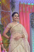Actress Rakul Preet Singh Stills in Golden Embroidery saree at Rarandoi Veduka Chuddam Audio Launch .COM 0006.jpg