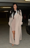 Kim Kardashian flaunts pregnancy curves in a pink mini dress in London