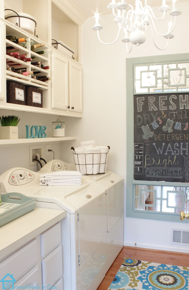 laundry room with chalkboard, basket of towels and build-ins with wine holder