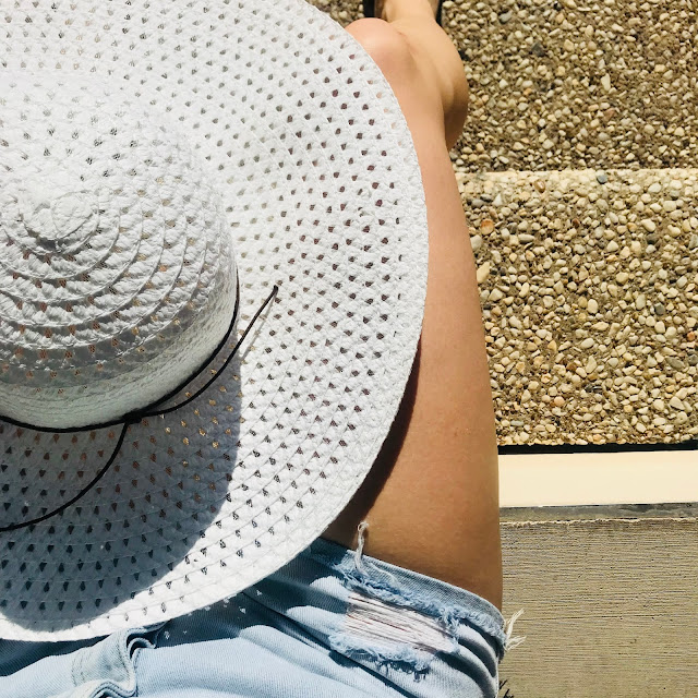 Giant white floppy hat from Walmart to wear on labor day