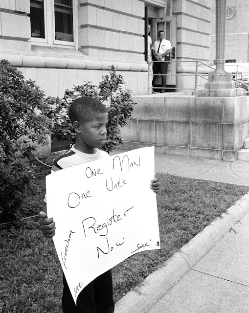 CIvil Rights Vote Young boy in front of Dallas County courthouse in Selma on July 8, 1964.