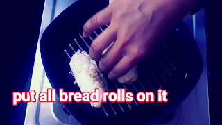 image of putting bread rolls on a grill pan