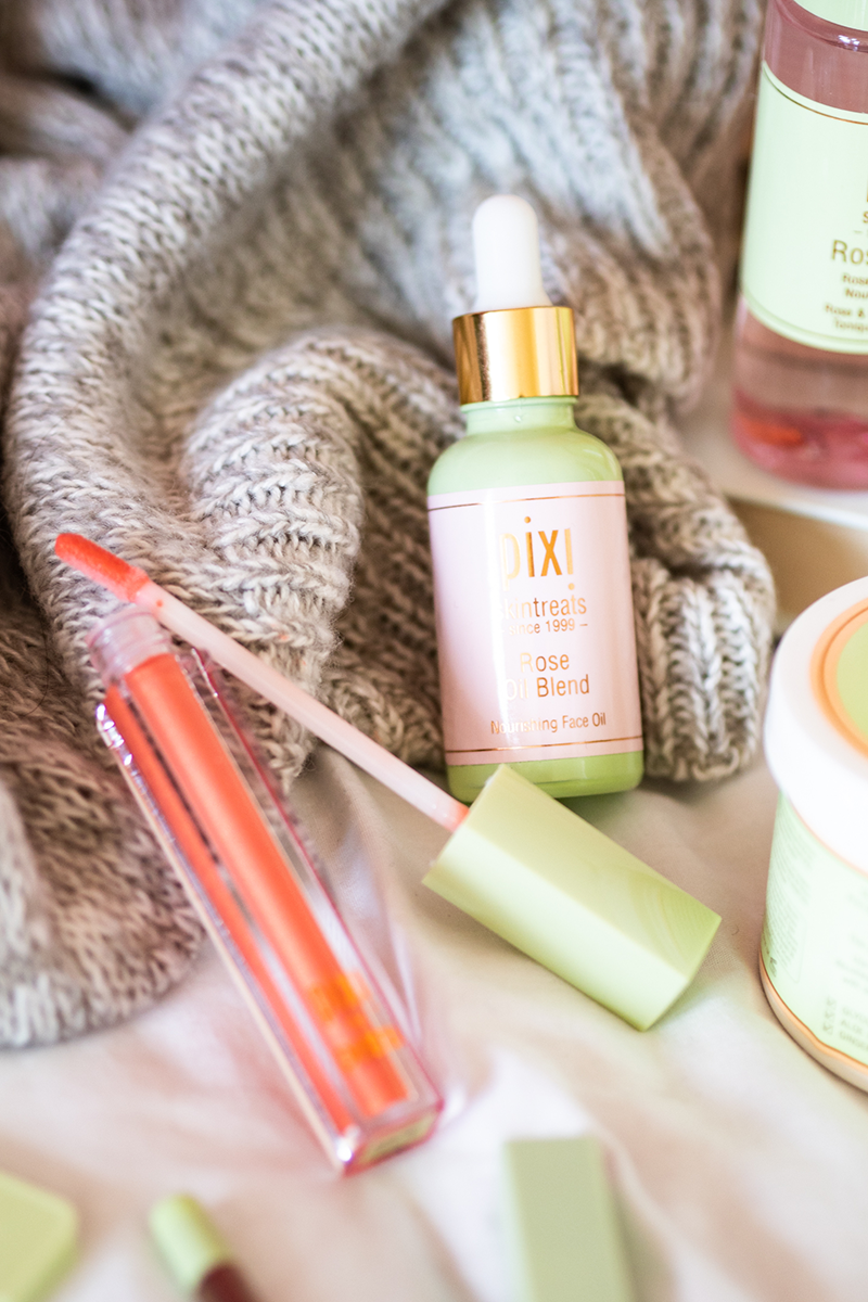 Picture of Pixi Beauty Rose Blend Oil lying on a blanket