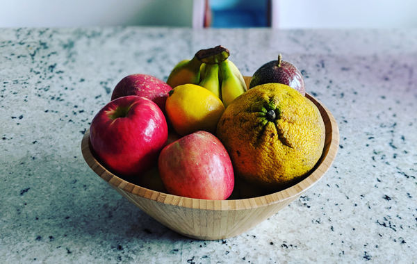 image of a bowl of fruit sitting on my kitchen counter