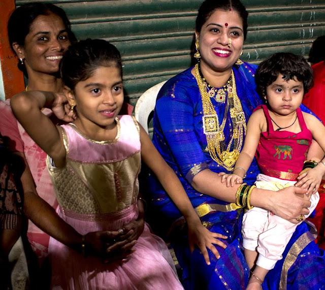 laughter joy happiness decked up festival holi koli fisherfolk women children versova mumbai india