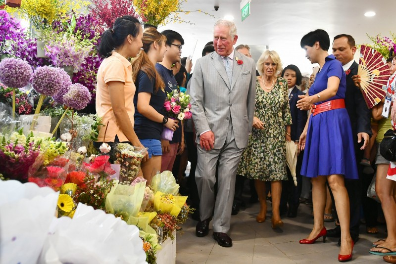Britain's Prince Charles, Prince of Wales and Camilla, Duchess of Cornwall at Tiong Bahru Market.