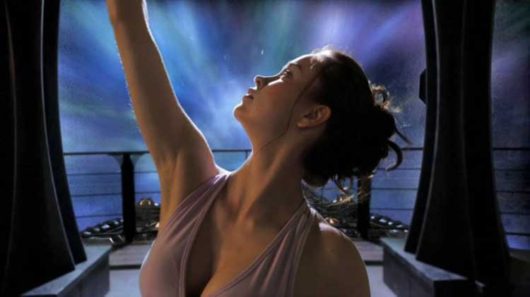 "Chloe relaxes while doing yoga in Stargate Universe's ""Life"""