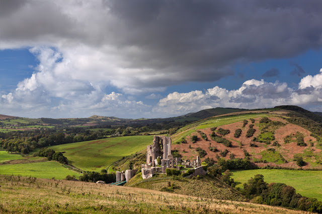 Dorset landscape surrounds the historic ruins of Corfe Castle