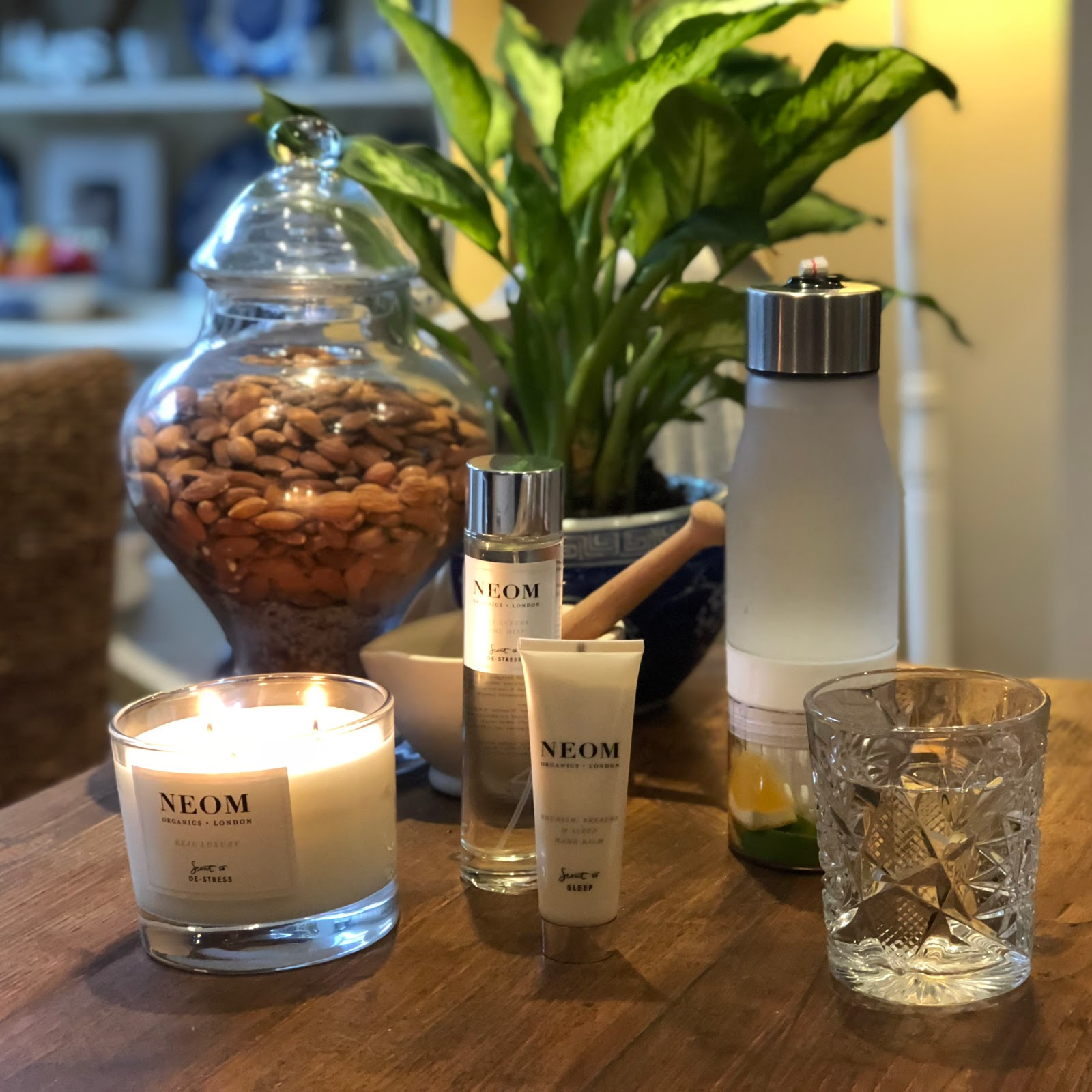my midlife fashion, marks and spencer, neom real luxury scent to de-stress candle, neom nourish breathe and calm hand balm, neom de-stres home mist, marks and spencer hydrate bottle